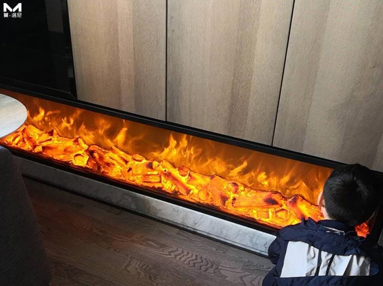 12月的哈尔滨用这台电壁炉取暖,只穿背心也汗流浃背